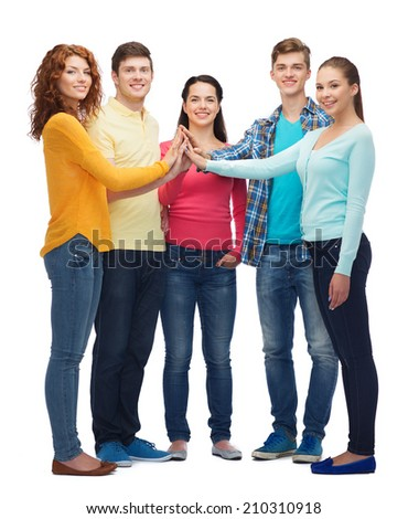 friendship, youth, gesture and people - group of smiling teenagers making high five