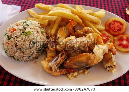 Fries and rice with shrimp.