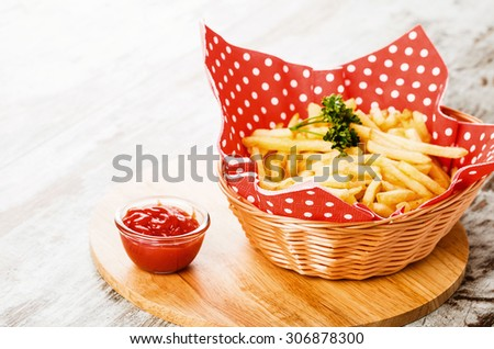 fries on wooden table - stock photo