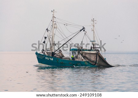 FRIESLAND, NORTH SEA, GERMANY - MAY 19. Trawler in the wadden Sea on May 19, 2014. Shrimper in the North Sea. It is one of the oldest cultural techniques in the fisheries in the North Sea - stock photo
