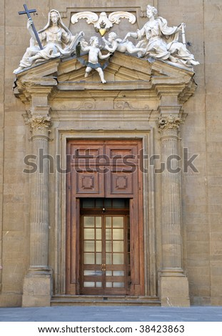 Frieze and side entrance door - Palazzo Vecchio Florence, Italy - stock photo