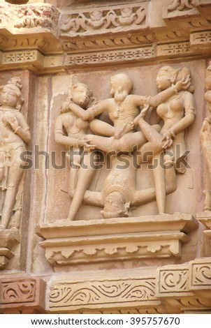 Frieze of gods, apsaras and mythical creatures on  Jain Temple, Khajuraho in India, Asia - stock photo