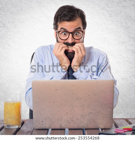Frightened businessman over textured background  - stock photo