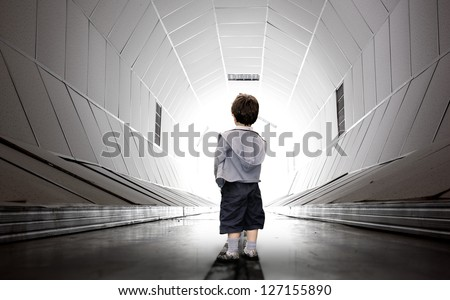 Frightened child walking towards the white tunnel