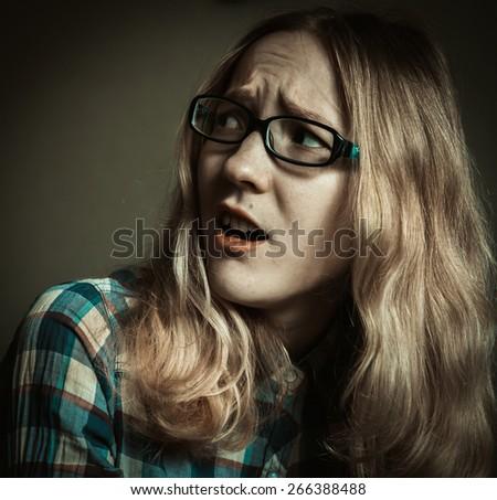 Frightened girl.  LOMO toned photo. - stock photo