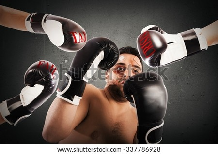Frightened man boxer with plasters and bruises - stock photo