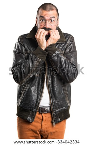 Frightened man wearing a leather jacket  - stock photo