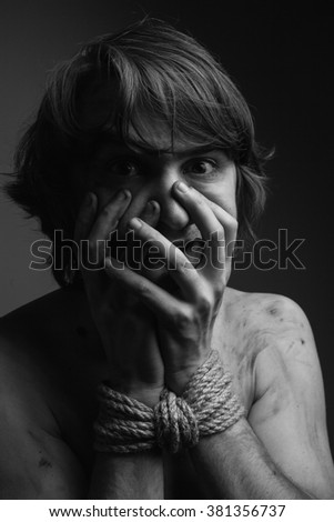 Frightened  man with bound hands. Black and White
