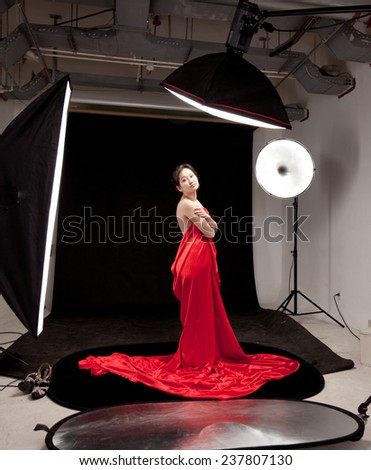 Frightened model during shooting session - stock photo