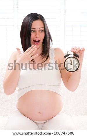 frightened pregnant woman anticipating childbirth ambulances - stock photo