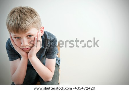 Frightened victim of bullying - stock photo