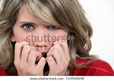 Frightened woman - stock photo