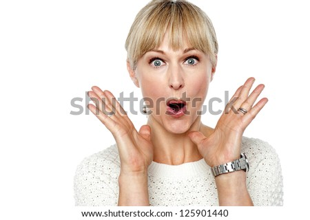Frightened woman with a smile on her face isolated on white. - stock photo