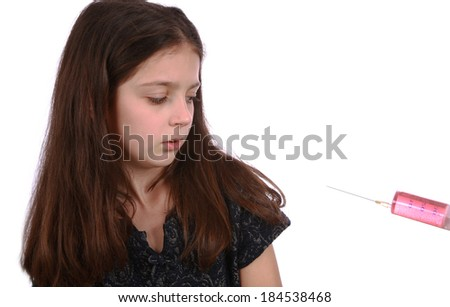 Frightened young girl getting an injection - stock photo
