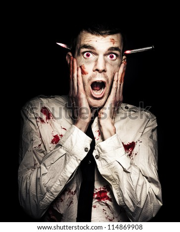 Frightened Zombie Business Man Displaying A Expression Of Terror In A Shock Horror Concept On Black Background - stock photo