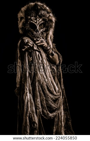 Frightening female wearing mask of skull. Fantasy. Halloween. Witchcraft, voodoo dances. - stock photo