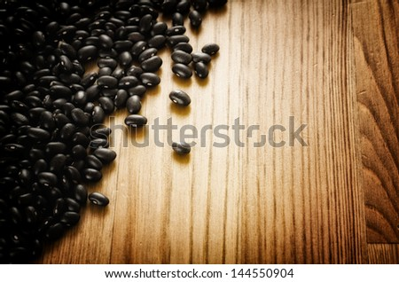 Frijoles, mexican black beans, on wooden background, biologic culture - stock photo