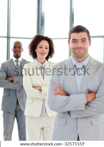Frinedly young businesswoman with folded arms in a line