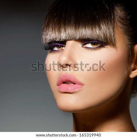 Fringe. Fashion Model Girl With Trendy Hairstyle and Makeup closeup. Haircut. Stylish Beauty Brunette Woman Face. Beautiful Make up. Vogue Style. Hair cut. Perfect Skin - stock photo