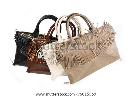 fringe handbags isolated on white - stock photo