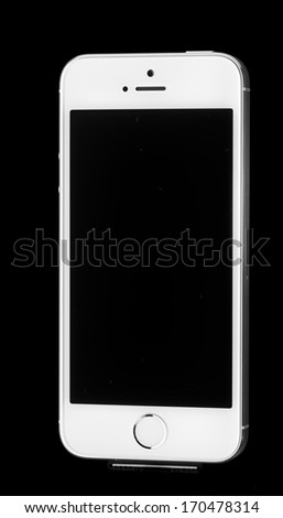 Frisco, TX - November 23, 2013: Photo of a brand new iPhone 5S. iPhone 5S is a smartphone developed by Apple Inc. It is part of the iPhone line. iPhone is world favorite smartphone. - stock photo