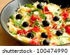 Frittata, delicious omelet with cheese, tomatoes, arugula and olives - stock photo