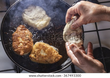 fritters fry on frying pan - stock photo