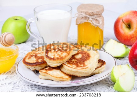 Fritters with apples and honey - stock photo