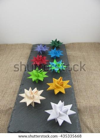 Froebel Stars on a slate plate - stock photo