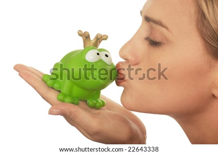 Frog price being kissed by a beautiful glamour model isolated on white