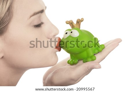 Frog price being kissed by a beautiful glamour model with pale skin isolated on white - stock photo