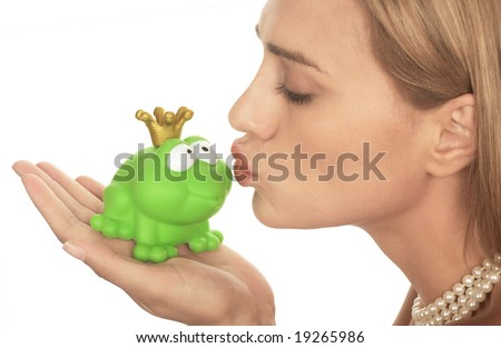 Frog prince being kissed by a beautiful glamor model isolated on white - stock photo