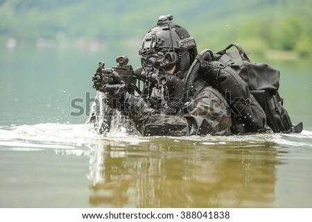 Frogman with complete diving gear and weapons in the water - stock photo