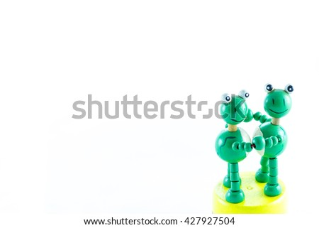 frogs wood craving toy dancing on the white background - stock photo