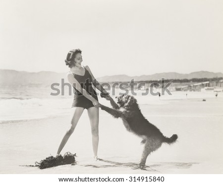 Frolicking on the beach - stock photo