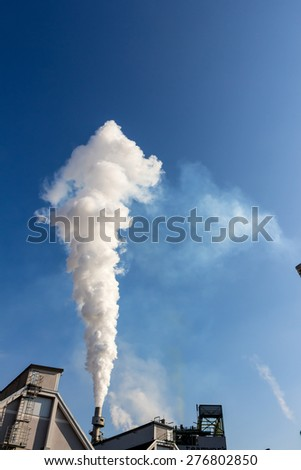 from a smoking stacks smokes white smog - stock photo