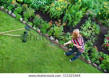 From above view on woman working in garden. - stock photo