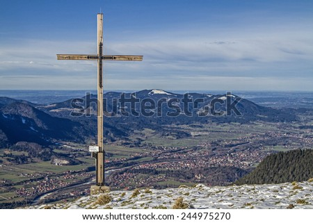From here you can enjoy a wonderful view of Brauneck, Benedict Wall and Lenggries - cross on the Schoenberg - stock photo