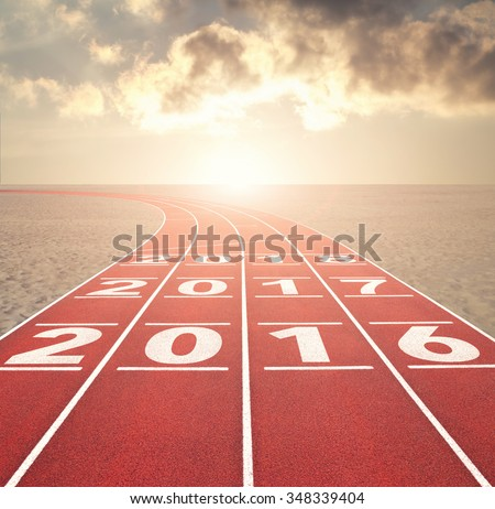 From 2016 into the future concept with numbers on running track in desert against sunset sky
