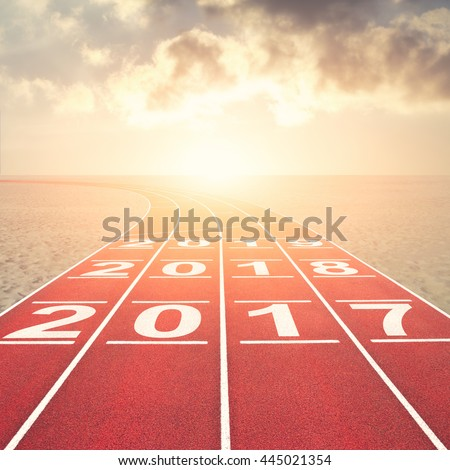 From 2016 into the future concept with numbers on running track in desert against sunset sky - stock photo