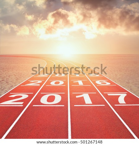 From 2017 into the past concept with numbers on running track in desert against sunset cloudy sky