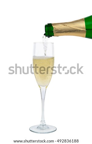 from the bottle is poured into a glass of champagne