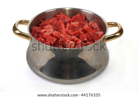From the meat of beef cut by small cubes, the tasty goulash will be prepared - stock photo