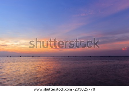 From the sea silhouette of fire sea sunset  - stock photo