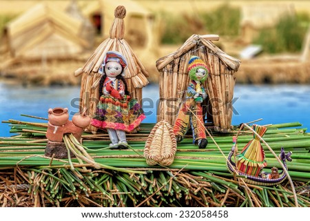 From the Uru People of the Titicaca lake created composition to document the life of the Urus. In the background blurred original Uru huts on a reed island. - stock photo