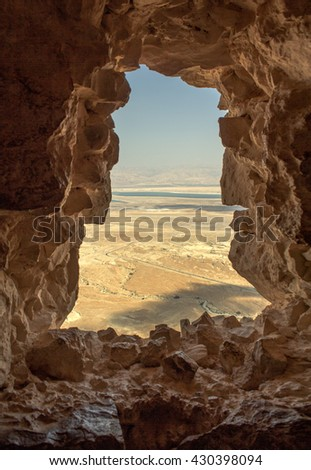 From the window of the fortress of Masad. MASADA, HISTORICAL PLACE IN ISRAEL. Dramatic and breath-taking desert views surround the mountaintop fortress of Masada in Israel. - stock photo
