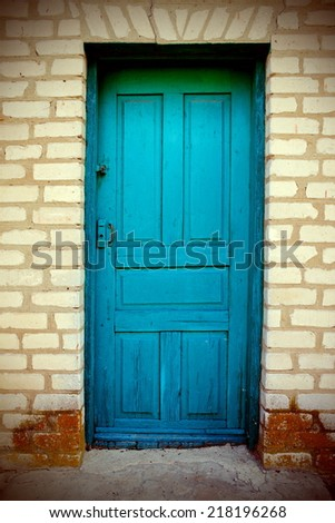 From time to time the old shabby doors - stock photo