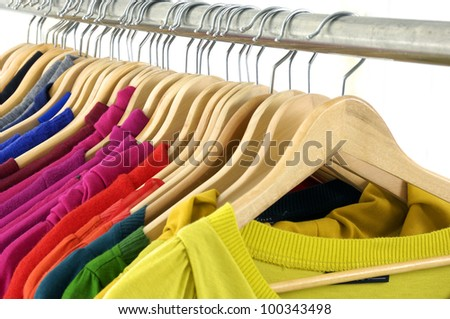 From view female colorful shirt clothing on hangers