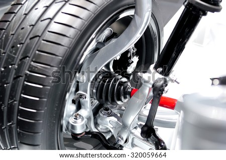 Front axle with suspension and absorber. - stock photo