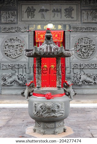 Front chinese door with a lion hand door  - stock photo